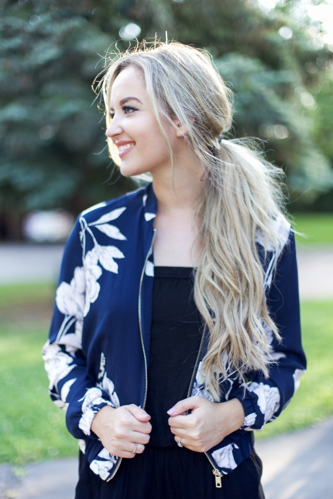 Floral bomber and black jumpsuit